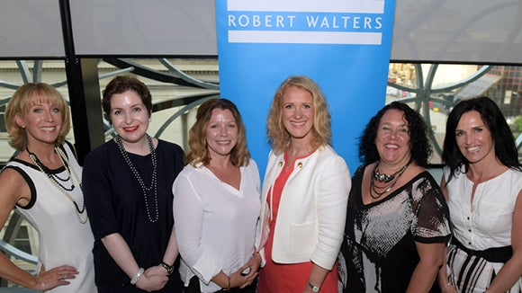 panel of 6 women at robert walters event in birmingham standing in front of blue robert walters sign